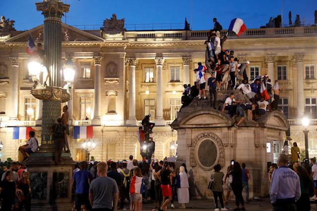 France fans stand in front of the Hotel Crillon as they wait for the arrival of the France soccer team after their victory in the 2018 Russia Soccer World Cup, in Paris, France, July 16, 2018. REUTERS/Charles Platiau