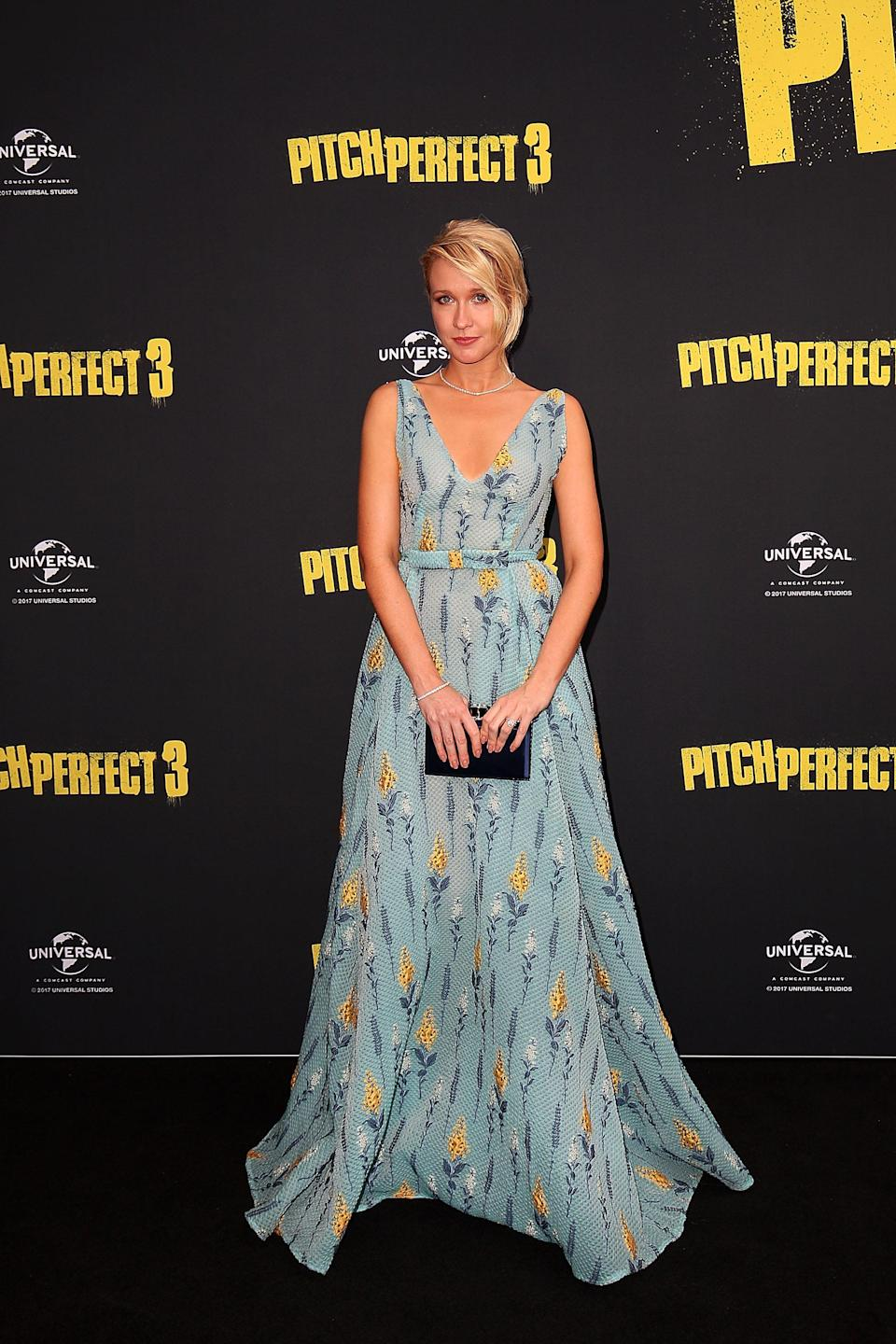 <p>Camp looked like a princess in a cute corn-print gown and navy box-clutch. (Photo: Getty Images) </p>