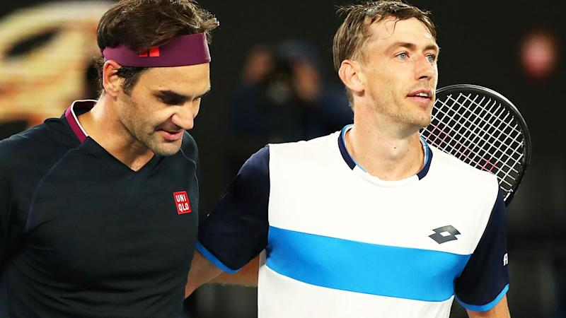 John Millman and Roger Federer, pictured here after their match at the Australian Open in January.