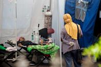 Indonesia has been battered by a virus explosion that has overwhelmed hospitals, leaving scores to die at home as desperate relatives hunt for oxygen tanks to treat the sick