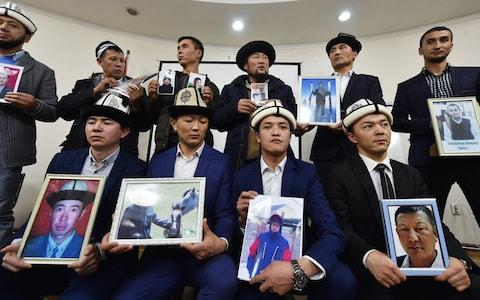"""Citizens of ex-Soviet Kyrgyzstan who fear relatives are being held in notorious """"re-education camps"""" in China's Xinjiang region - Credit: Vyacheslav OSELEDKO / AFP"""