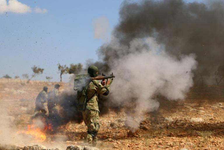 A Syrian rebel fighter takes part in combat training in northwestern Idlib province on September 11, 2018