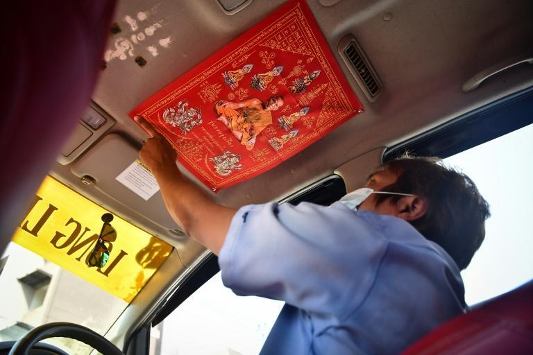 Wasan's cab has a large cloth scroll featuring a Buddhist monk