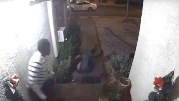 PHOTO: In this still image from a video captured by a doorbell camera outside a home in Las Vegas, an unidentified woman is seen falling on her back after being kicked down the stairs by an unidentified man, Jan. 1, 2020. (Las Vegas Metropolitan Police)