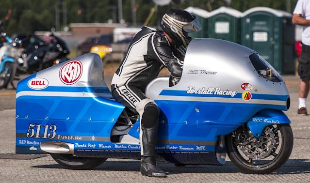 Bill Warner, 44, of Wimauma, Fla., waits to make a high-speed run at The Maine Event on Sunday, July 14, 2013, in Limestone, Maine. Warner, who was trying to top 300 mph, died later Sunday after losing control of his motorcycle and zooming off a runway at a former air base in northern Maine. (AP Photo/Peter Freeman) NO SALES