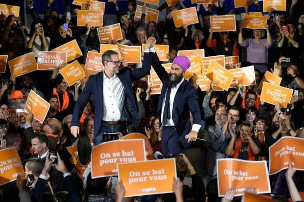 Singh, centre right, and Alexandre Boulerice, NDP incumbent for Rosemont—La Petite-Patrie, attend a rally with supporters in Montreal during the 2019 federal election campaign.