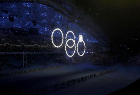 Four out of five of the Olympic rings are seen lit up during the opening ceremony of the 2014 Sochi Winter Olympics, February 7, 2014. REUTERS/Mark Blinch