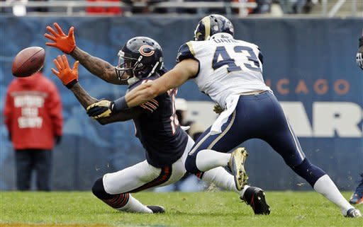 Chicago Bears wide receiver Brandon Marshall (15) misses a catch while covered by St. Louis Rams safety Craig Dahl (43) in the first half of an NFL football game in Chicago, Sunday, Sept. 23, 2012. (AP Photo/Nam Y. Huh)