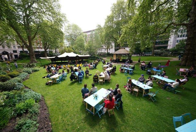 Londoners enjoy a performance by percussion group Beaten Track, during a free ticketed outdoor picnic concert in Portman Square Garden, organised by Wigmore Hall as part of its 120th anniversary celebrations