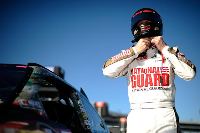 FORT WORTH, TX - NOVEMBER 04: Dale Earnhardt Jr., driver of the #88 National Guard Chevrolet, stands by his car after qualifying for the NASCAR Sprint Cup Series AAA Texas 500 at Texas Motor Speedway on November 4, 2011 in Fort Worth, Texas. (Photo by Jared C. Tilton/Getty Images for NASCAR)