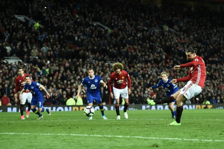 Manchester United's striker Zlatan Ibrahimovic shoots from the penalty spot to scores his team's first goal during the English Premier League football match against Everton at Old Trafford in Manchester, England, on April 4, 2017