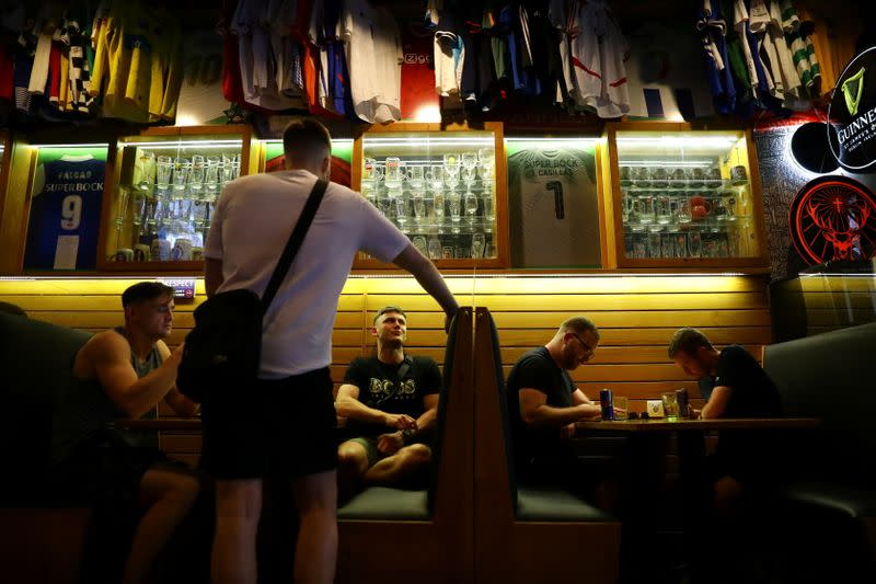 Soccer fan patrons are seen at the Adega Sports Bar as thousands of English fans start arriving to Portugal's northern city of Porto for the Champions League final and hotels and bars hope for a boost after the tourism sector was ravaged by the coronavirus
