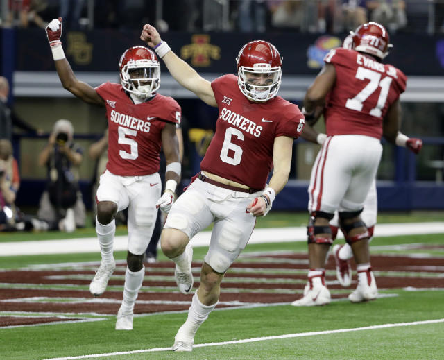 Oklahoma's Baker Mayfield (6) and Marquise Brown (5) face a Georgia defense that is fourth nationally in scoring defense. (AP)