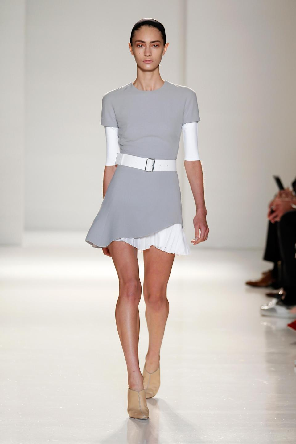 <p>Shortly before opening her highly-anticipated Dover Street store (a reminder that she's a serious fashion player) – the designer debuted her SS15 line. Models stepped out in utilitarian workwear as Beckham returned to a more demure colour palette once again with boxy blazers and spring-fresh suits that wouldn't look out of place in our wardrobe RN. <em>[Photo: Getty]</em> </p>