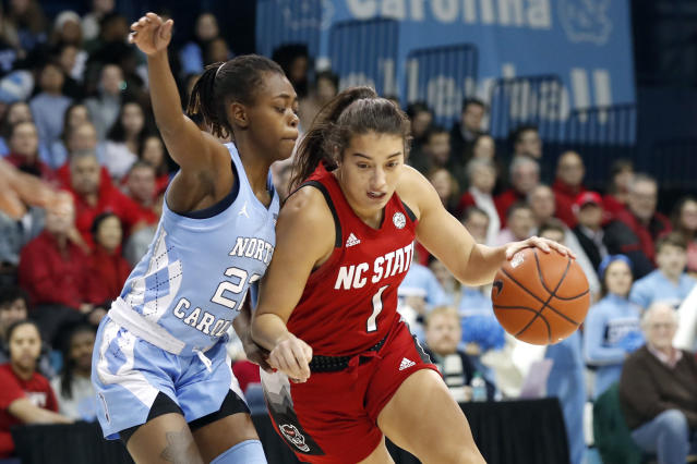 North Carolina guard Shayla Bennett (22) guards against North Carolina State guard Aislinn Konig (1) during the first half of an NCAA college basketball game in Chapel Hill, N.C., Thursday, Jan. 9, 2020. (AP Photo/Gerry Broome)