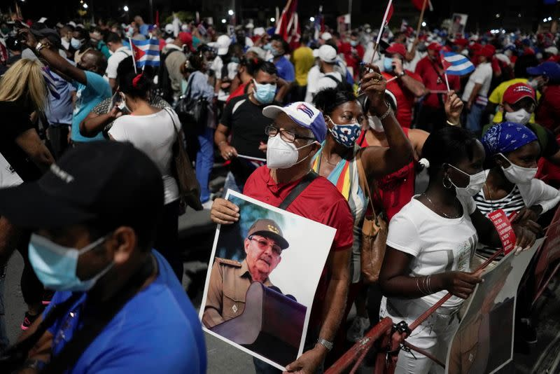 A man holds an image of Raul Castro durig a rally in Havana