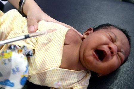 A baby cries during diphtheria immunisation at a clinic in Cibinong, Bogor, West Java