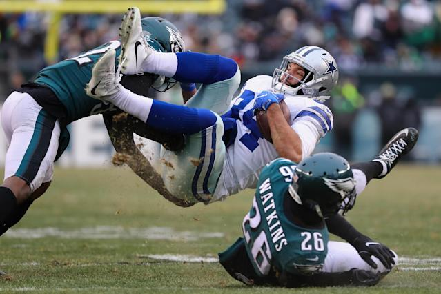 <p>Tight end James Hanna #84 of the Dallas Cowboys is tackled by cornerback Rasul Douglas #32 and cornerback Jaylen Watkins #26 of the Philadelphia Eagles during the second half of the game at Lincoln Financial Field on December 31, 2017 in Philadelphia, Pennsylvania. (Photo by Elsa/Getty Images) </p>