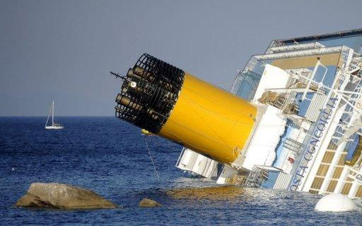 <p>View of the Costa Concordia on January 14, 2012, after the cruise ship ran aground and keeled over off the Italian island of Giglio. South African salvage master Nick Sloane was flown to the island last year from New Zealand for the biggest ever salvage operation of a passenger ship.</p>