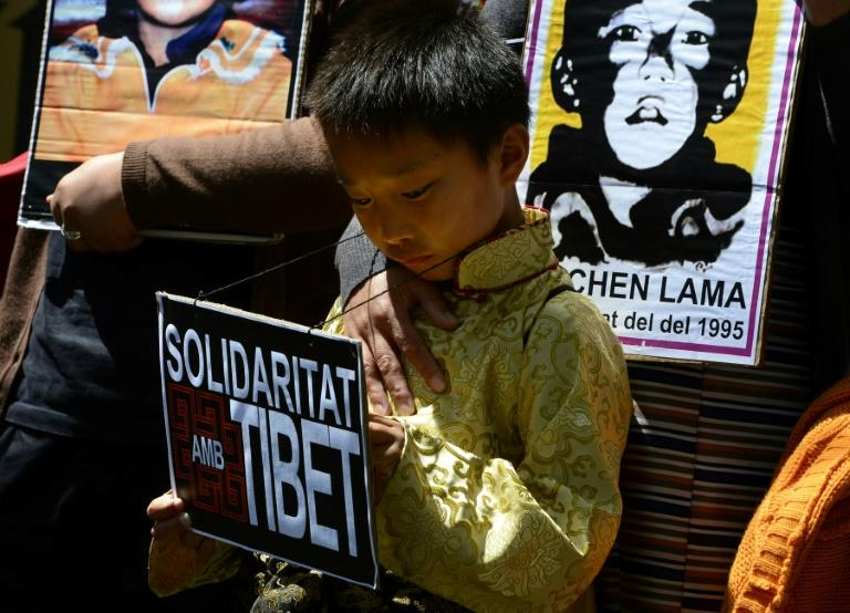 Protesters hold picures of Gendun Cheokyi Nyima, recognized as the Panchen Lama by the Dalai Lama, during a demonstration outside the Chinese consulate in Barcelona in 2013