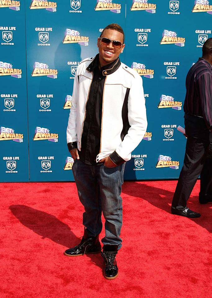"R and B star Chris Brown popped a pose upon arriving at the 2008 BET Awards at the Shrine Auditorium in Los Angeles. Love the smile, hate the jacket. Frazer Harrison/<a href=""http://www.gettyimages.com/"" target=""new"">GettyImages.com</a> - June 24, 2008"