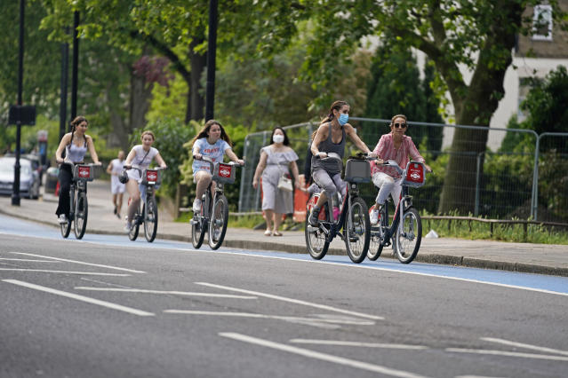 People ride bicycles in a cycle lane in Chelsea, London. (PA)