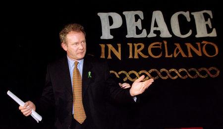 FILE PHOTO: Sinn Fein Chief Negotiator Martin McGuinness speaks to reporters at a news conference February 26, 1998. REUTERS/Paul Hackett/File Photo