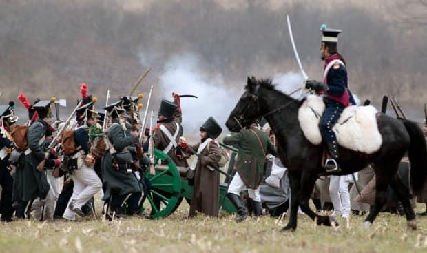 People dressed in historic uniforms take part in a re-enactment of the 1812 Battle of Berezina to mark the 200th anniversary of the battle near the village of Bryli, 115 kilometres east of Minsk, Belarus, on Nov. 24, 2012. The battle between the attacking imperial Russian army and Napoleon's retreating army ended in a victory for Russia and heavy losses for the French.