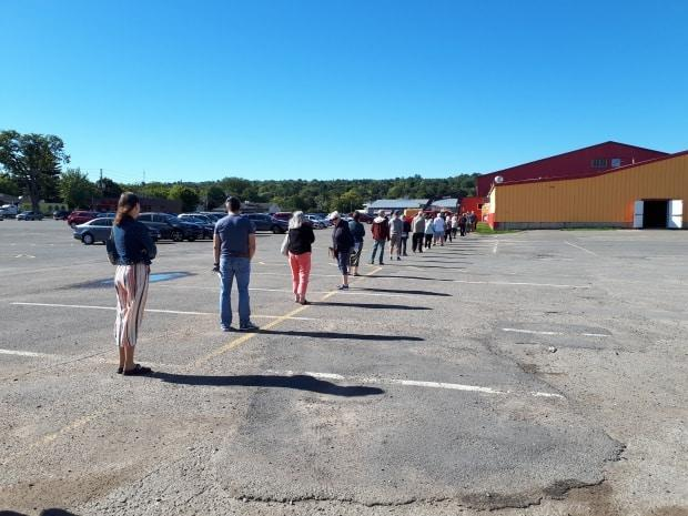 Voters line up to vote outside Exhibition Stadium in Fredericton during advance voting for the New Brunswick provincial election in September.