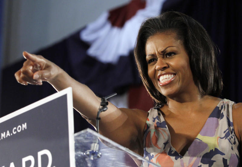 First Lady Michelle Obama points to supporters at the War Memorial auditorium  Wednesday, Aug. 22, 2012 in Fort Lauderdale, Fla. (AP Photo/Alan Diaz)