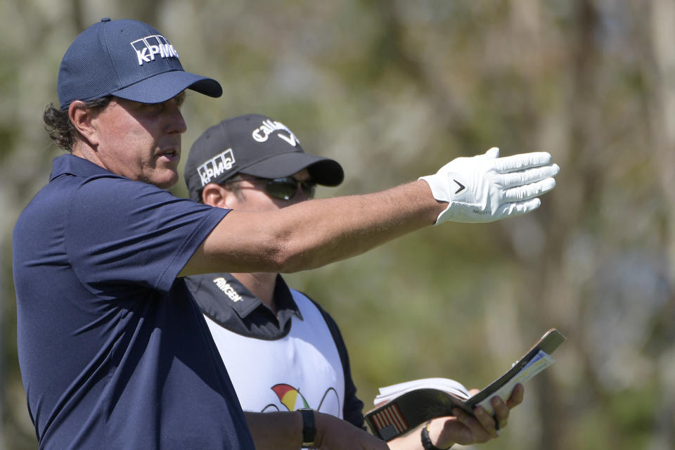 Phil Mickelson lines up a tee shot on the third hole during the second round of the Arnold Palmer Invitational golf tournament at Bay Hill, Friday, March 8, 2019, in Orlando, Fla. (AP Photo/Phelan M. Ebenhack)