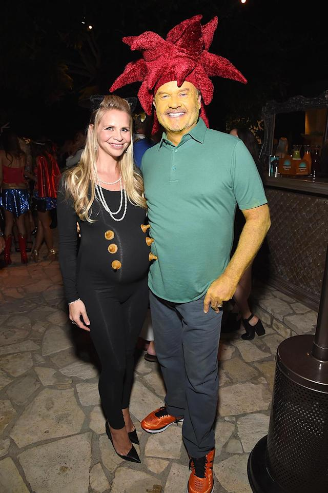 <p>The former <i>Frasier</i> star (with his pregnant wife, Kayte) cleverly dressed up as Sideshow Bob, the character he voices on <i>The Simpsons</i>. He earns extra points for the yellow body paint. (Photo: Michael Kovac/Getty Images) </p>