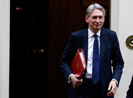 FILE PHOTO:Britain's Chancellor of the Exchequer Philip Hammond leaves 11 Downing Street, London