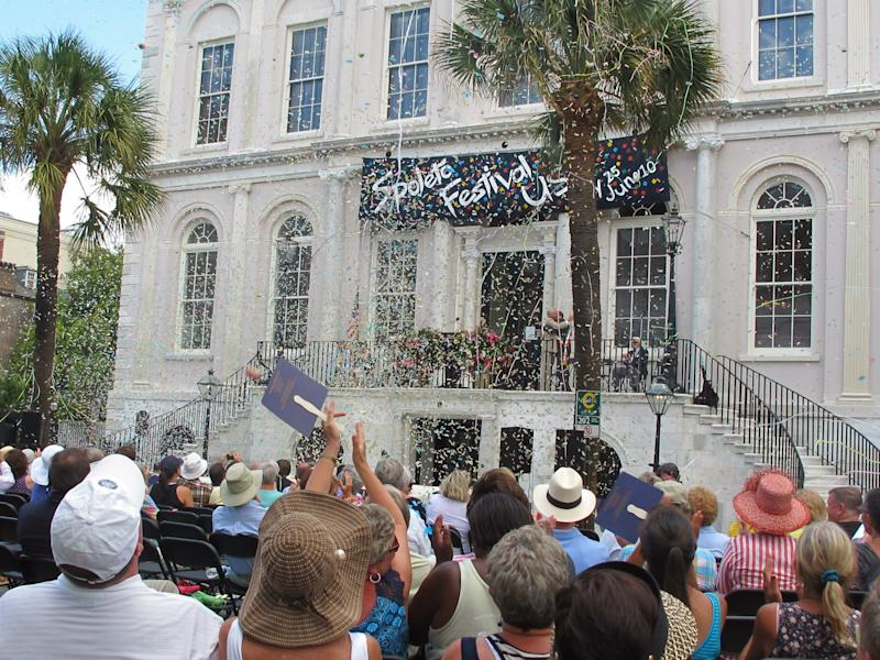 Confetti rains down on the crowd during the opening ceremonies of the Spoleto Festival USA in Charleston, S.C., on Friday, May 25, 2012. The internationally known arts festival was opening its 36th season. (AP Photo/Bruce Smith)