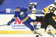 Buffalo Sabres forward Jeff Skinner (53) collides with a Pittsburgh Penguins player during the first period of an NHL hockey game, Saturday, April 17, 2021, in Buffalo, N.Y. (AP Photo/Jeffrey T. Barnes)