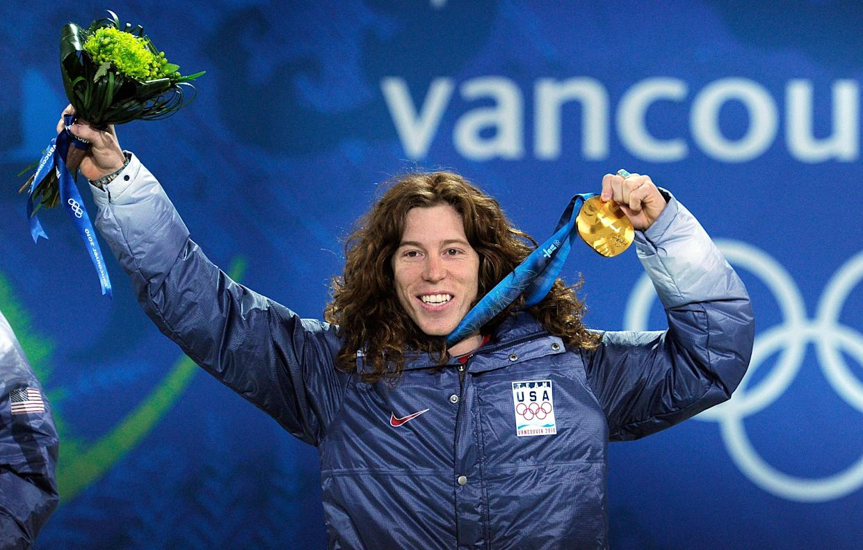 Shaun White of United States celebrates his gold medal during the 2010 Vancouver medal ceremony for the Men's Halfpipe in Canada. Kevork Djansezian—Getty Images