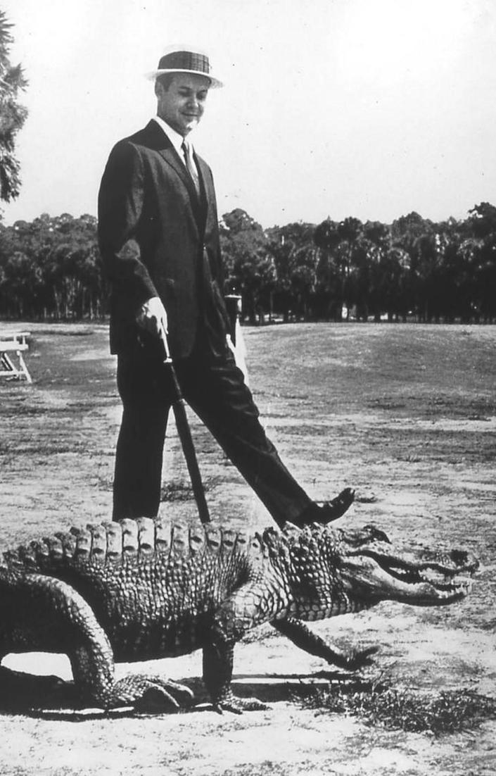 Charles Fraser and an alligator were caught on film together in this iconic image from a 1962 edition of The Saturday Evening Post, which featured Fraser's then-new Sea Pines Plantation. A statue made from this image stands in the Compass Rose Park on Pope Avenue, which honors Fraser, his family and his company.