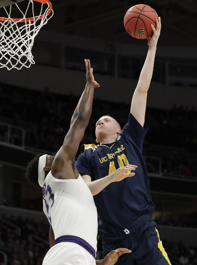 UC Irvine forward Collin Welp, right, shoots over Kansas State forward Austin Trice during the second half of a first-round game in the NCAA mens college basketball tournament Friday, March 22, 2019, in San Jose, Calif. (AP Photo/Chris Carlson)
