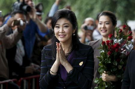 Ousted former Thai Prime Minister Yingluck Shinawatra gestures as she arrives at the Supreme Court, for a trial on criminal negligence looking into her role in a debt-ridden rice subsidy scheme during her administration, in Bangkok
