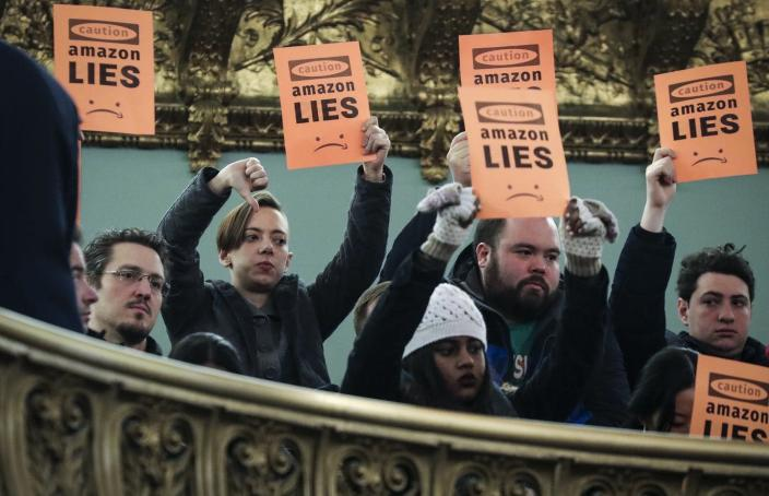 """<span class=""""caption"""">Protestors voice their displeasure during a New York City Council hearing on Amazon's plan to locate a headquarters in the city.</span> <span class=""""attribution""""><a class=""""link rapid-noclick-resp"""" href=""""https://www.gettyimages.com/detail/news-photo/protestors-voice-their-displeasure-during-a-new-york-city-news-photo/1091271432?adppopup=true"""" rel=""""nofollow noopener"""" target=""""_blank"""" data-ylk=""""slk:Drew Angerer/Getty Images"""">Drew Angerer/Getty Images</a></span>"""