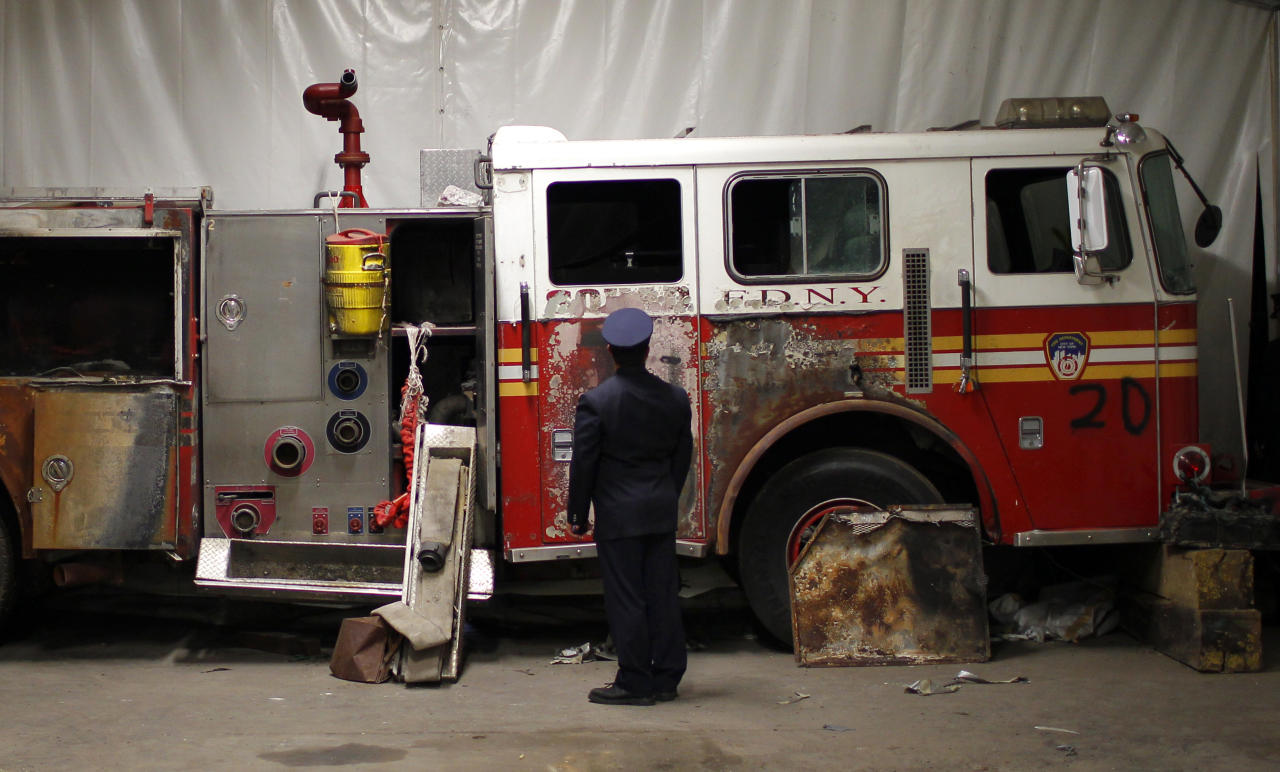 A New York City Fire Department engine recovered from the World Trade Center disaster site sits inside Hangar 17 at New York's John F. Kennedy International Airport June 16, 2011. A program operated by the Port Authority of New York and New Jersey, The World Trade Center steel program, is selecting portions of the steel recovered from the World Trade Center and donating it to cities, towns, firehouses and museums around the U.S. and the world who request it for use in 911 memorial sites in time for the 10 year anniversary of the 2001 attacks. Picture taken June 16, 2011.  (REUTERS/Mike Segar)