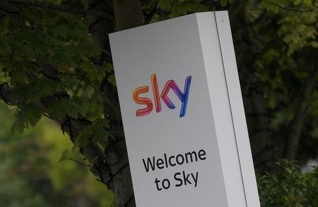 FILE PHOTO: The Sky logo is seen outside of an entrance to offices and studios in west London, Britain June 29, 2017. REUTERS/Toby Melville/File Photo