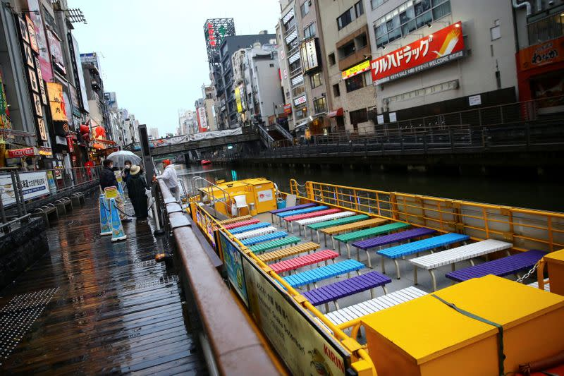 A ship is pictured on an almost empty pier in the Dotonbori entertainment district of Osaka