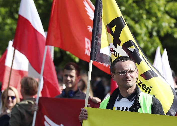 """Thousands of Polish nationalists march to the U.S. Embassy, in Warsaw, Poland, Saturday, May 11, 2019. Thousands of Polish nationalists have marched to the U.S. Embassy in Warsaw, protesting that the U.S. is putting pressure on Poland to compensate Jews whose families lost property during the Holocaust. The protesters included far-right groups and their supporters. They said the United States has no right to interfere in Polish affairs and that the U.S. government is putting """"Jewish interests"""" over the interests of Poland. (AP Photo/Czarek Sokolowski)"""