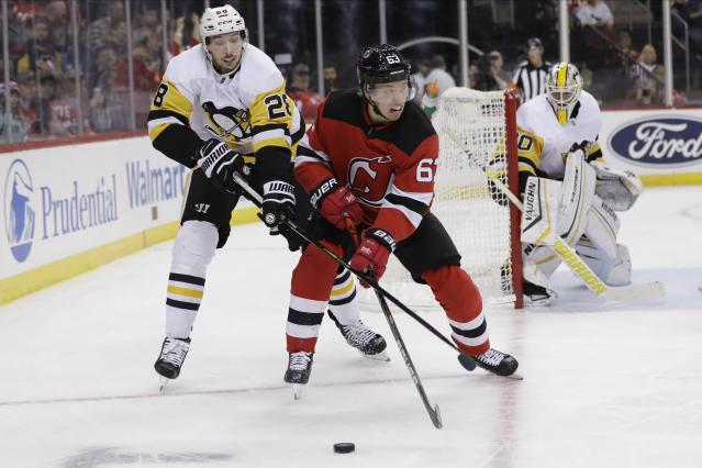 Pittsburgh Penguins' Marcus Pettersson (28) defends against New Jersey Devils' Jesper Bratt (63) during the second period of an NHL hockey game Friday, Nov. 15, 2019, in Newark, N.J. (AP Photo/Frank Franklin II)