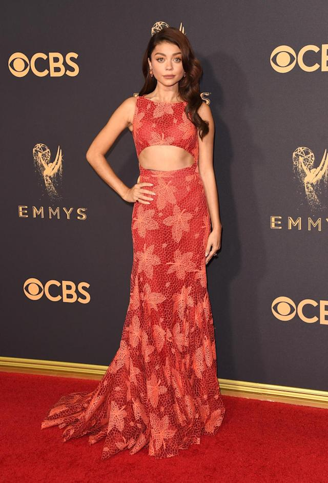 <p>The <em>Modern Family </em>actress rocked a floral burnt-orange gown featuring a cutout that flashed her abs.<br> (Photo: Getty Images) </p>