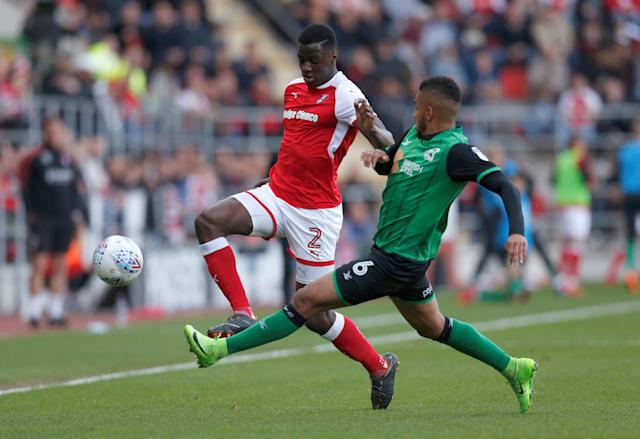 "Soccer Football - League One Play Off Semi Final Second Leg - Rotherham United vs Scunthorpe United - AESSEAL New York Stadium, Rotherham, Britain - May 16, 2018 Rotherham United's Josh Emmanuel in action with Scunthorpe United's Funso Ojo Action Images/Ed Sykes EDITORIAL USE ONLY. No use with unauthorized audio, video, data, fixture lists, club/league logos or ""live"" services. Online in-match use limited to 75 images, no video emulation. No use in betting, games or single club/league/player publications. Please contact your account representative for further details."