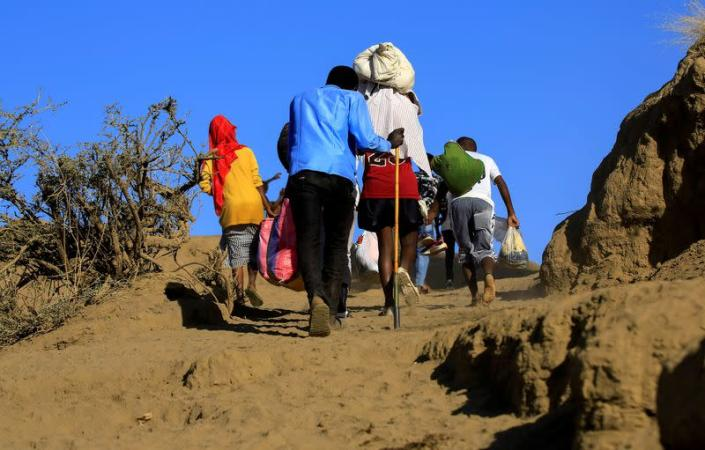 FILE PHOTO: FILE PHOTO: Ethiopians cross into Sudan as they flee the fighting to settle in the Hamdayet village on the Sudan-Ethiopia border