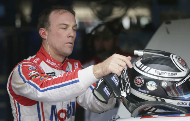 Kevin Harvick takes off his helmet during a practice session for a NASCAR Cup series auto race at Texas Motor Speedway in Fort Worth, Texas, Friday, Nov. 3, 2017. (AP Photo/LM Otero)