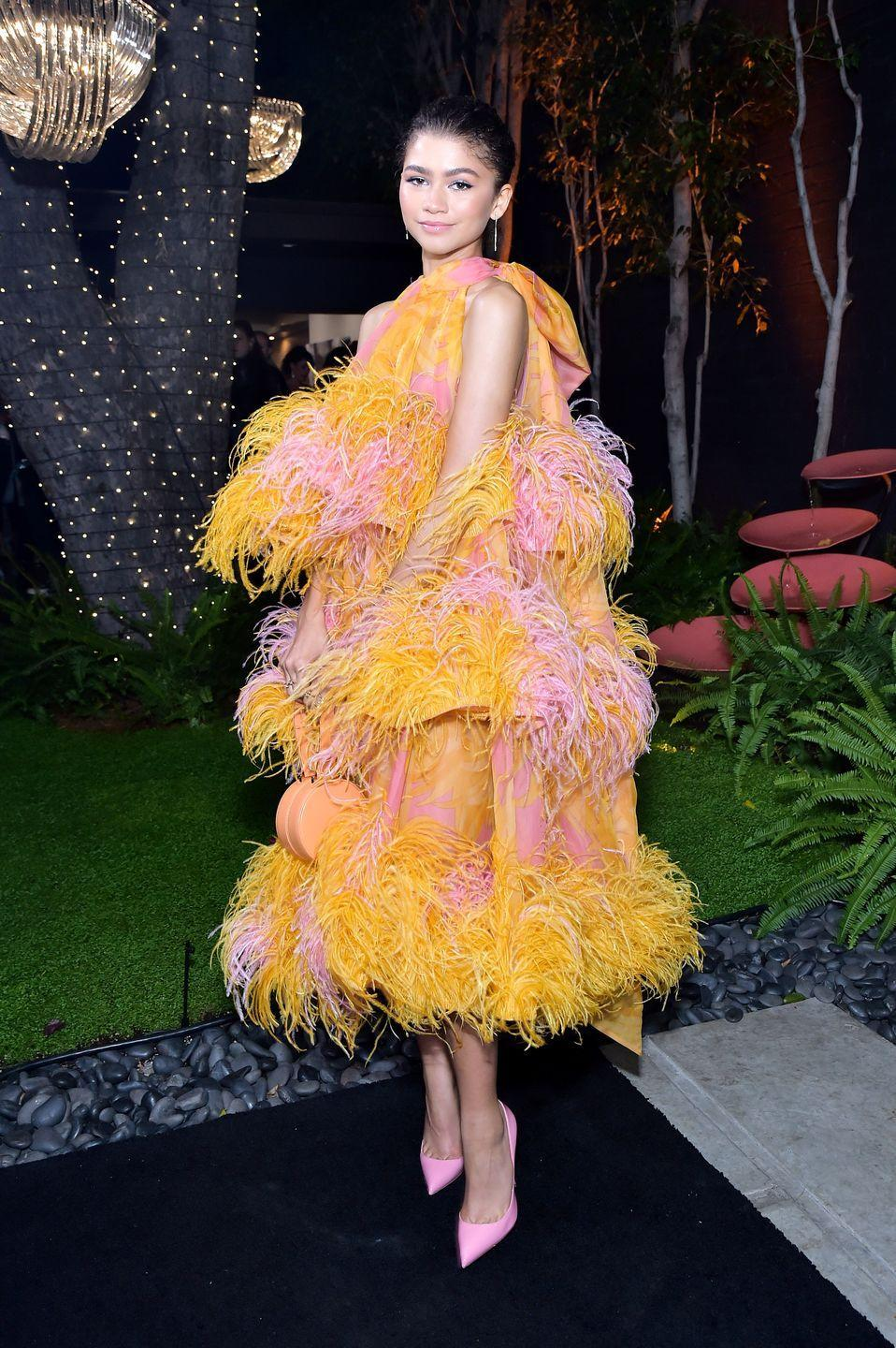 <p>At the Âme Jewelry brand launch party, she wore this eye-popping pink-and-orange feathered dress from Marc Jacobs' spring 2019 collection.</p>